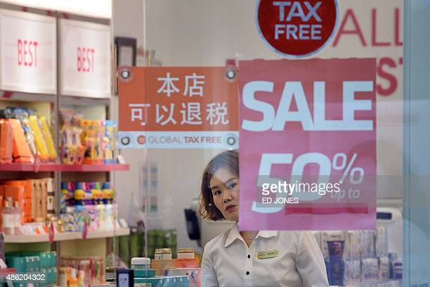 Sale signs are displayed in the window of a cosmetics shop in Seoul on September 2 2015 South Korea's exports in August suffered their biggest fall...