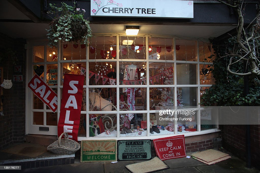 Sale signs offer pre-Christmas discounts in a gift shop on December 7, 2011 Knutsford, England. With a weak outlook at the start of the Christmas shopping boom, many retailers are slashing prices with the hopes of combating weak sales.