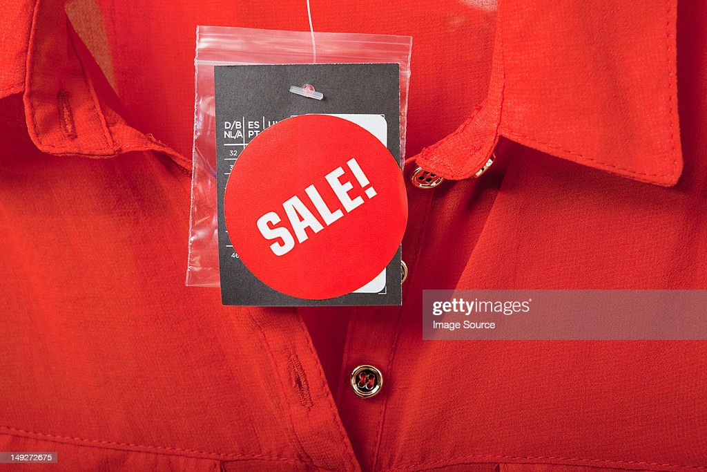 Sale tag on red blouse