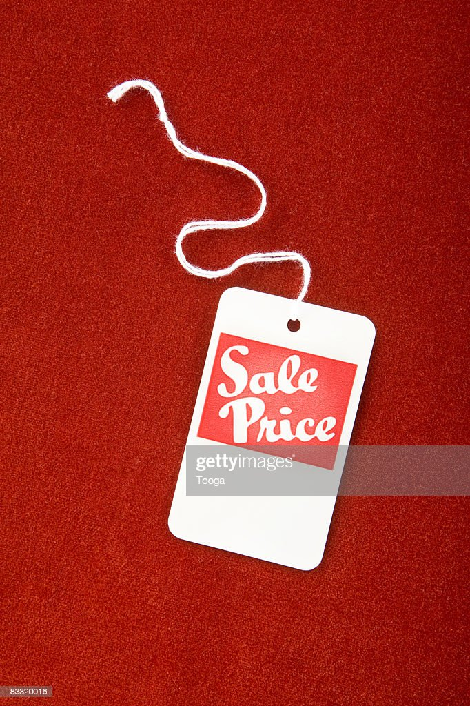 Sale tag on red velvet : Foto de stock