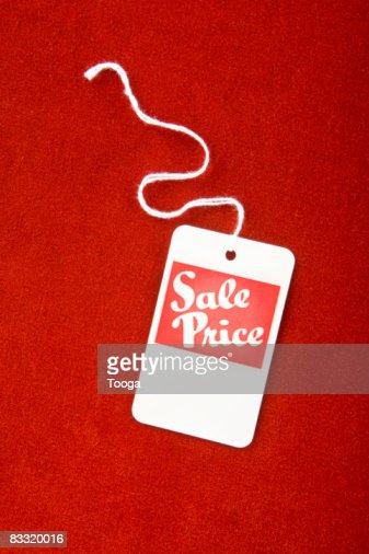 Sale tag on red velvet : Stockfoto