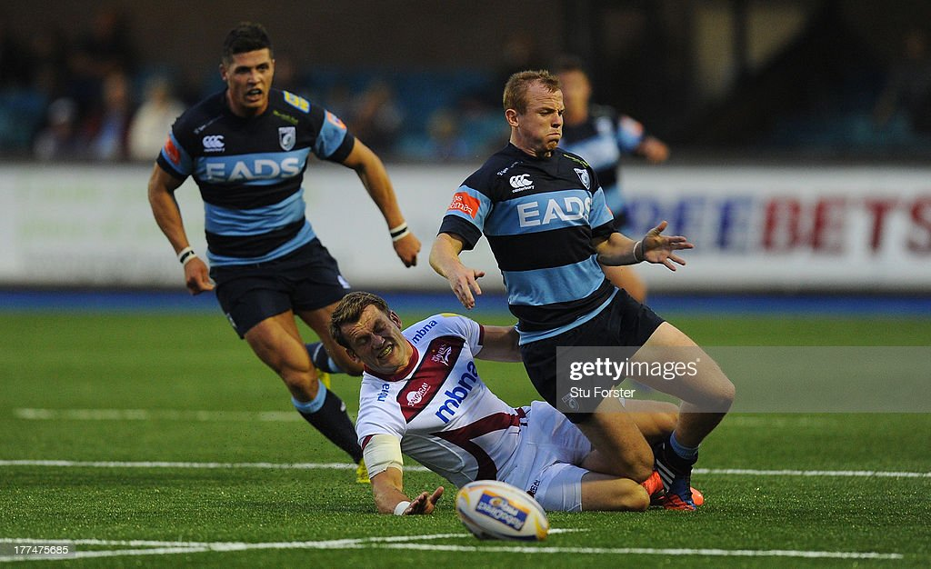 Sale winger <a gi-track='captionPersonalityLinkClicked' href=/galleries/search?phrase=Mark+Cueto&family=editorial&specificpeople=204783 ng-click='$event.stopPropagation()'>Mark Cueto</a> (l) tackles Blues wing Dan Fish only to be yellow carded during the pre-season friendly match between Cardiff Blues and Sale Sharks at Cardiff Arms Park on August 23, 2013 in Cardiff, Wales.