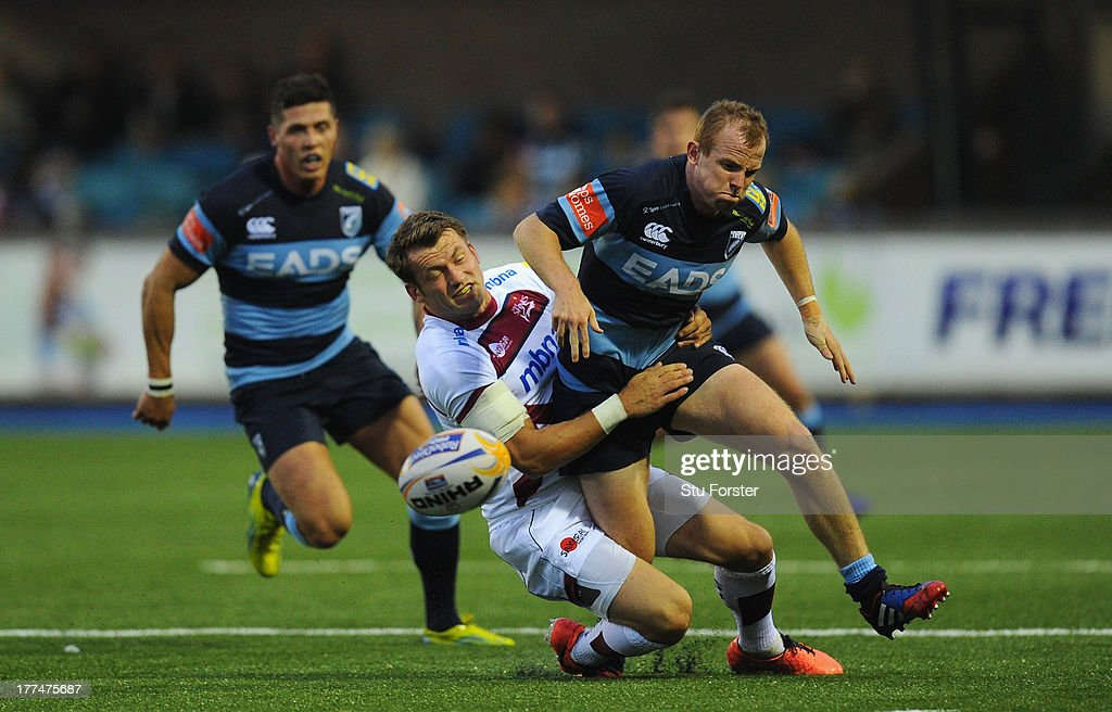 Sale winger Mark Cueto (l) tackles Blues wing Dan Fish only to be yellow carded during the pre-season friendly match between Cardiff Blues and Sale Sharks at Cardiff Arms Park on August 23, 2013 in Cardiff, Wales.
