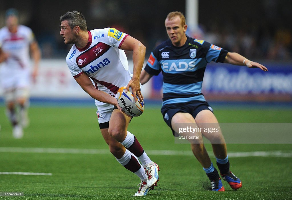 Sale winger Thomas Brady (l) in action as Blues wing Dan Fish looks on during the pre-season friendly match between Cardiff Blues and Sale Sharks at Cardiff Arms Park on August 23, 2013 in Cardiff, Wales.