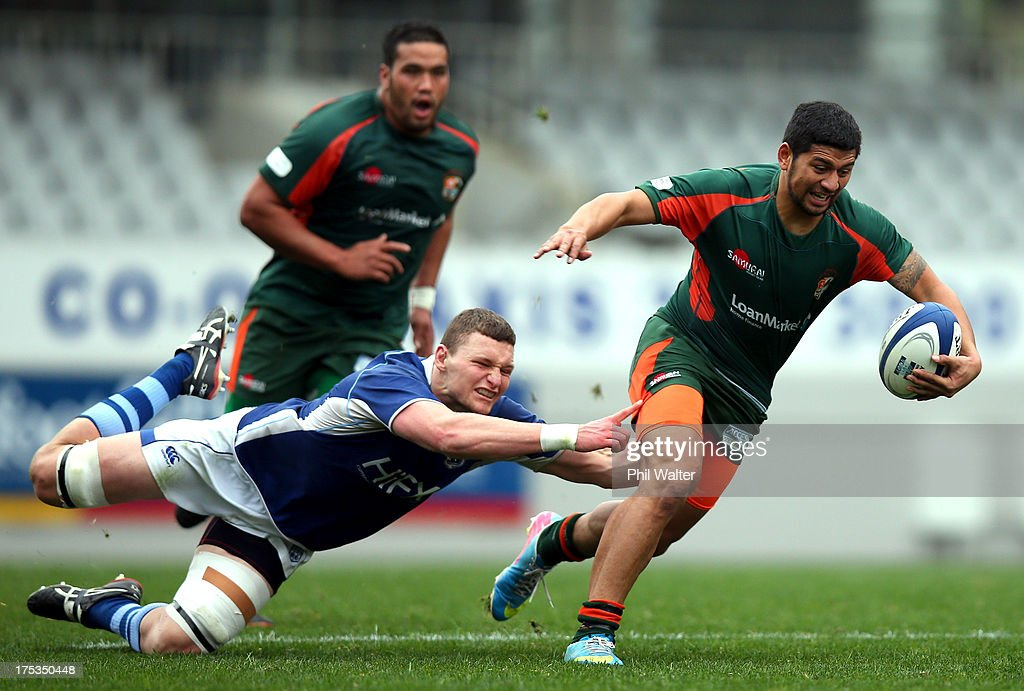 Saleaula Silipa of Pakuranga is tackled by Sean Brookman of University during the Gallaher Shield Final match between Pakuranga and University at Eden Park on August 3, 2013 in Auckland, New Zealand.
