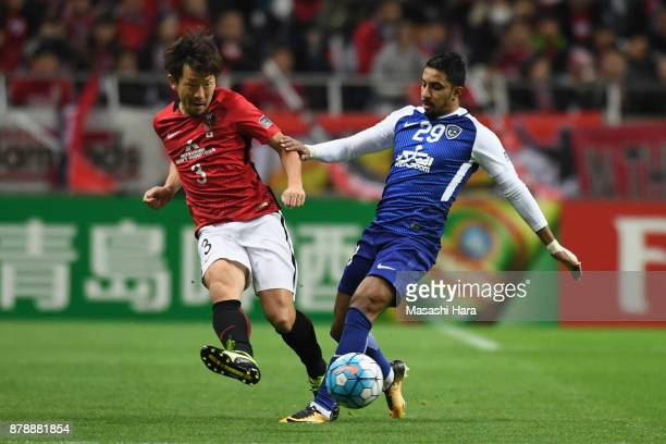 Salem Al Dawsari of AlHilal and Tomoya Ugajin of Urawa Red Diamonds compete for the ball during the AFC Champions League Final second leg match...