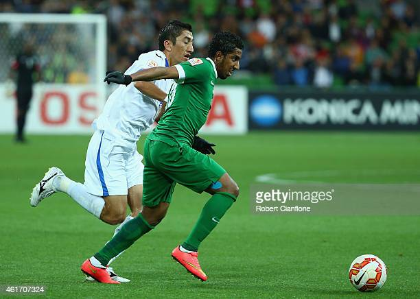Salem Aldawsari of Saudi Arabia is chased by Odil Akhmedov of Uzbekistan during the 2015 Asian Cup match between Uzbekistan and Saudi Arabia at AAMI...