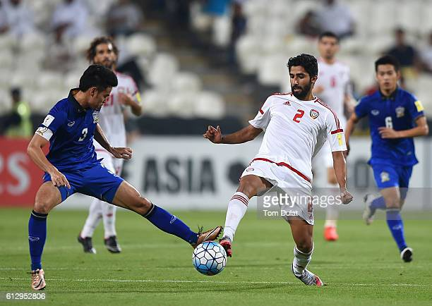 Salem Saleh Al Rejaibi of UAE and Theerathon Bunmathan of Thailand battle for the ball during the 2018 FIFA World Cup Qualifier match between UAE and...