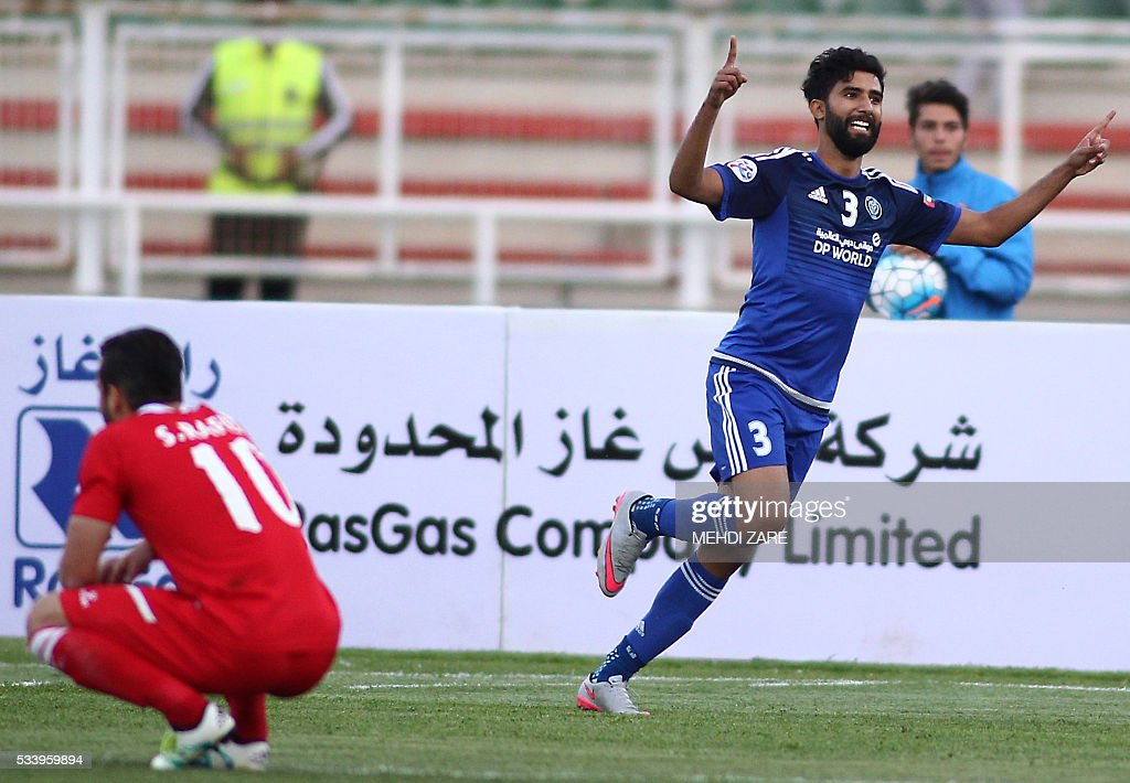 Salem Saleh al-Rejaibi of the UAE's al-Nasr club (R) celebrates after scoring against Iran's Tractorsazi club during their AFC Champions League round 16 football match at the Yadegar Imam stadium in Tabriz on May 24, 2016. / AFP / MEHDI