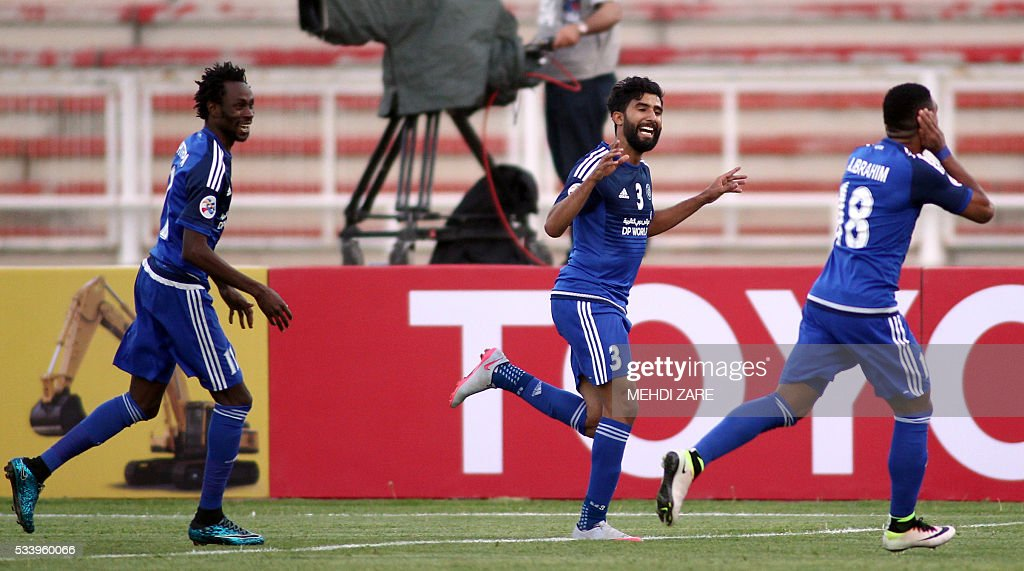 Salem Saleh al-Rejaibi of the UAE's al-Nasr club (C) celebrates with teammates after scoring against Iran's Tractorsazi club during their AFC Champions League round 16 football match at the Yadegar Imam stadium in Tabriz on May 24, 2016. / AFP / MEHDI
