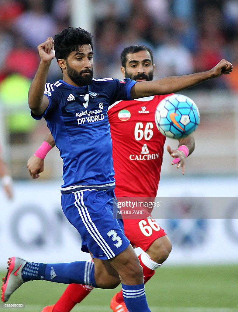 Salem Saleh al-Rejaibi of the UAE's al-Nasr club (L) challenges Mehdi Kiani of Iran's Tractorsazi during their AFC Champions League round 16 football match at the Yadegar Imam stadium in Tabriz on May 24, 2016. / AFP / MEHDI