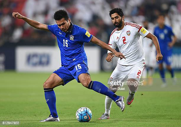 Salem Salem Al Rejaibi of UAE and Koravit Namwiset of Thailand in action during the 2018 FIFA World Cup Qualifier match between UAE and Thailand at...