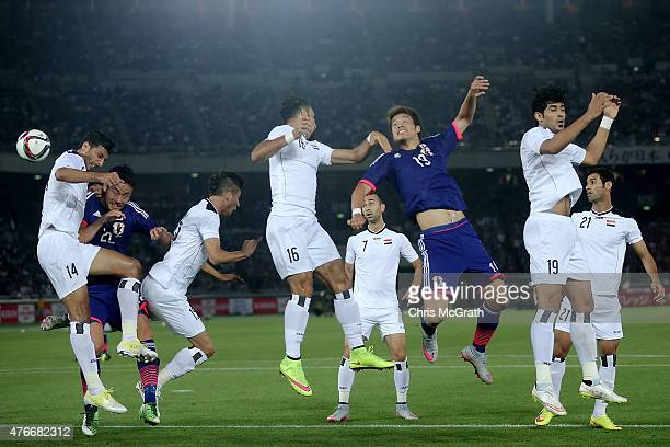 Salem Shakir of Iraq contests the ball with Yoshida Maya of Japan during the international friendly match between Japan and Iraq at Nissan Stadium on...