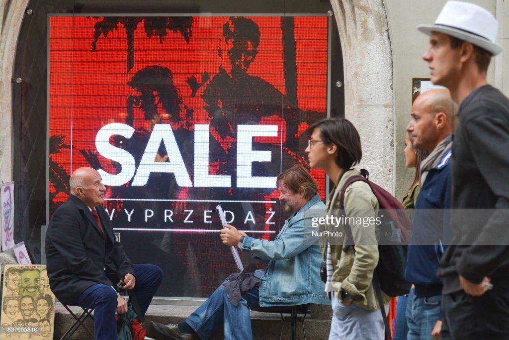 Sales Add seen on Florianska Street in Krakow's City Center. On Wednesday, August 22, 2017, in Krakow, Poland.