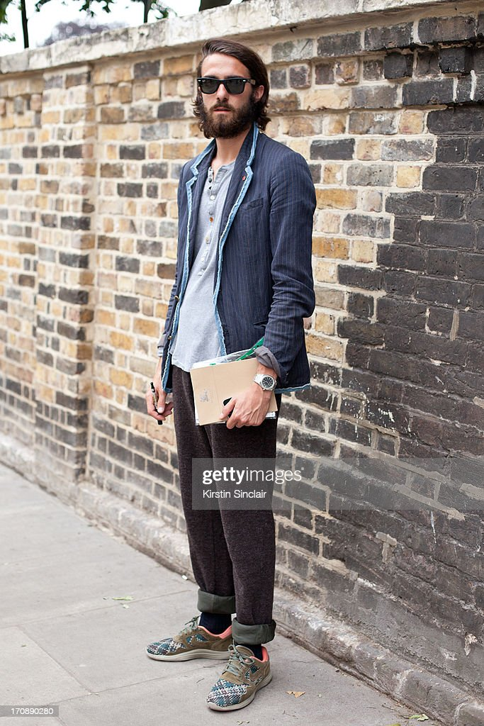 Sales Assistant at Browns Enrico Balafresi wears Kolor jacket, and trousers. And Nike shoes on day 3 of London Collections: Men on June 18, 2013 in London, England.