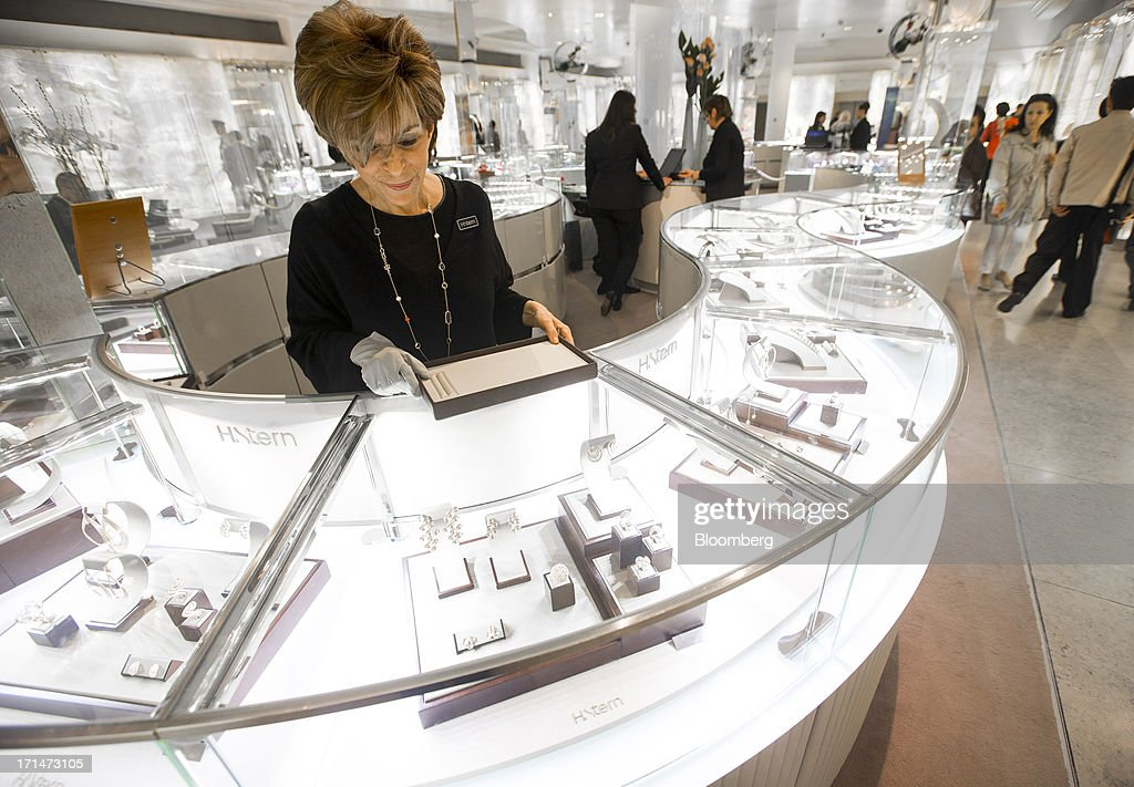 A sales assistant prepares a display in the jewelry department of Harrods luxury department store in London, U.K., on Monday, June 24, 2013. Harrods, which has more than 1 million square feet (90,000 square meters) of selling space, isn't concerned about the outlook for spending on luxury goods, Harrods Managing Director Michael Ward said. Photographer: Jason Alden/Bloomberg via Getty Images