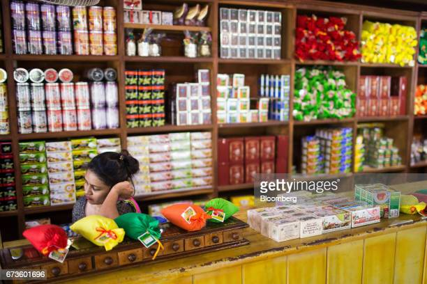 A sales assistant sits in the factory store that sells house brand teas of the Geragama Tea Estate operated by Pussellawa Plantations Ltd in...