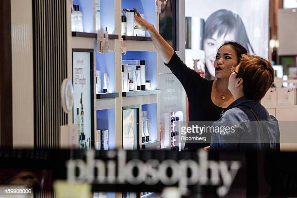 A sales assistant talks to a customer browsing cosmetics in the department store of the Siam Paragon shopping mall in Bangkok Thailand on Wednesday...