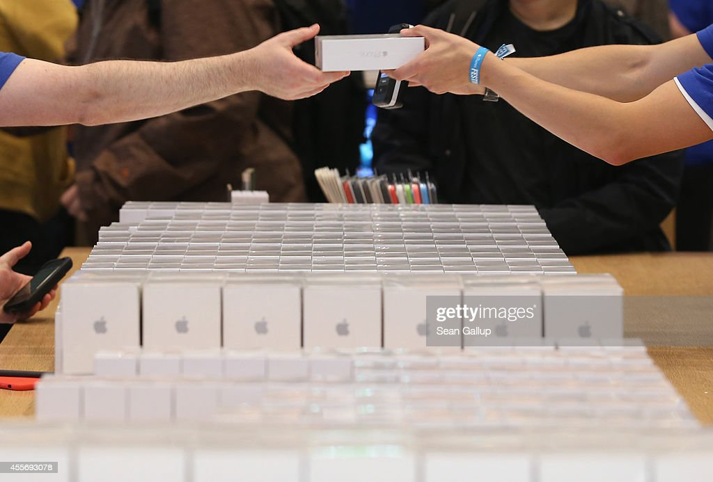 Sales assistants prepare new Apple iPhone 6 phones and other Apple products at the Apple Store on the first day of sales of the new phone in Germany...