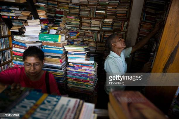 Sales assistants work in a book store in Colombo Sri Lanka on Thursday April 20 2017 The Central Bank of Sri Lanka is scheduled to announce its key...