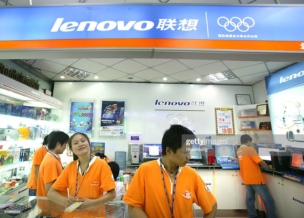 Sales assistants work in a Lenovo Group Ltd store at a technology mall in downtown Beijing China on Thursday Aug 2 2007 Lenovo Group Ltd the world's...