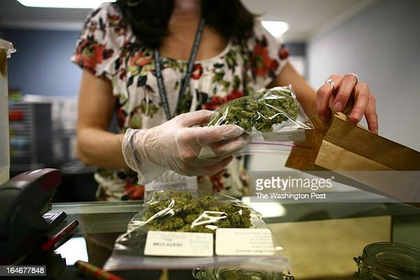 Sales associate Crystal Guess packages up a patient's cannabis inside a Good Meds medical cannabis center in Lakewood Colorado US on Monday March 4...