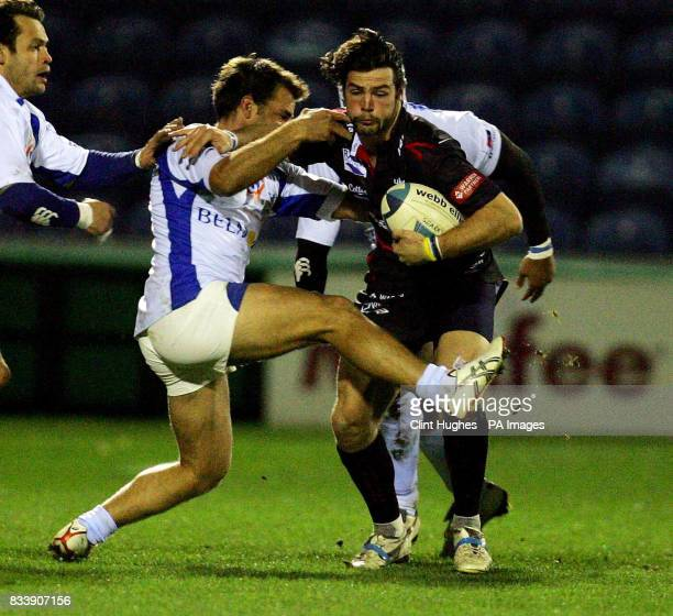 Sale's Ben Foden tries to drive through a tackle made by Montpellier's Sebastien Buada during the European Challenge Cup match at Edgeley Park...