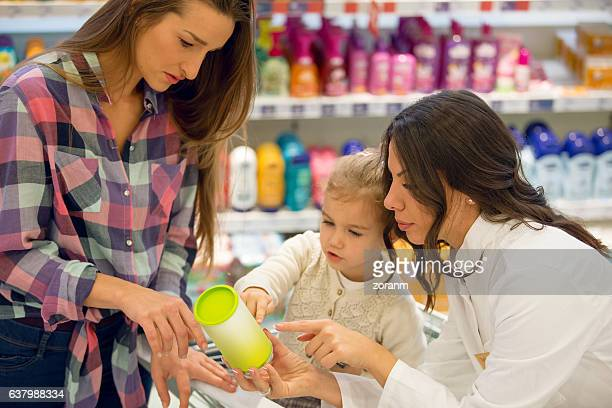 Sales clerk assisting family in shopping