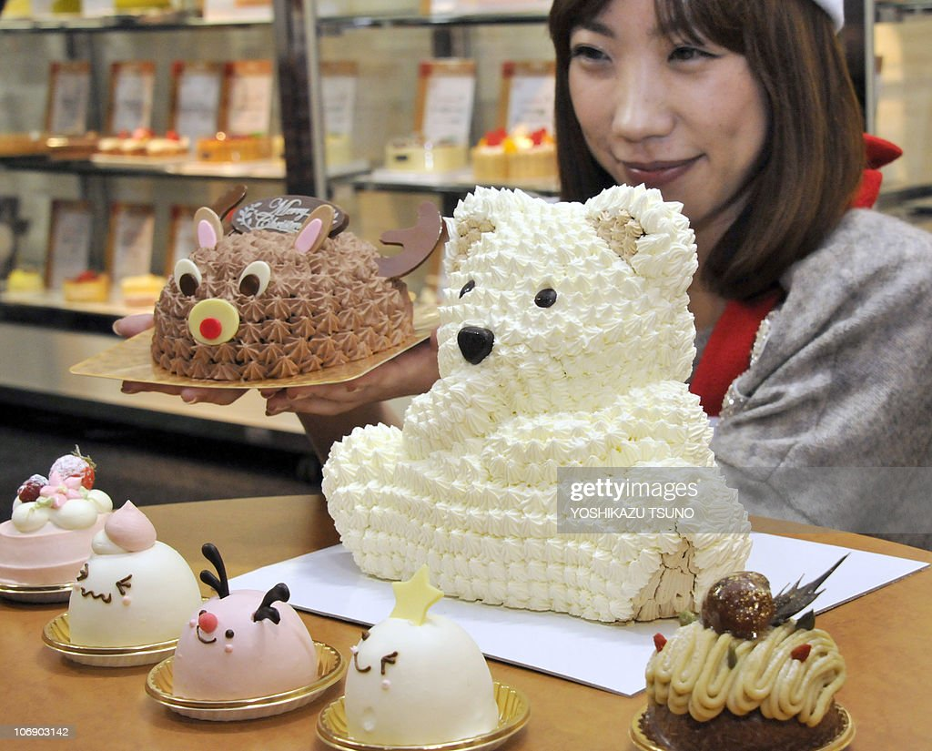 a s clerk from seibu department stor pictures getty images a s clerk from seibu department store displays a white chocolate polar bear cake c