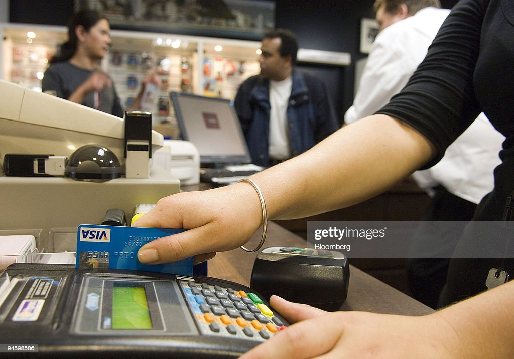 A sales clerk swipes a customer's Visa card at a shop in Wellington New Zealand on Tuesday Jan 15 2008 New Zealand consumer spending on debit credit...