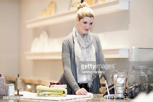 Sales clerk using computer : Stock Photo