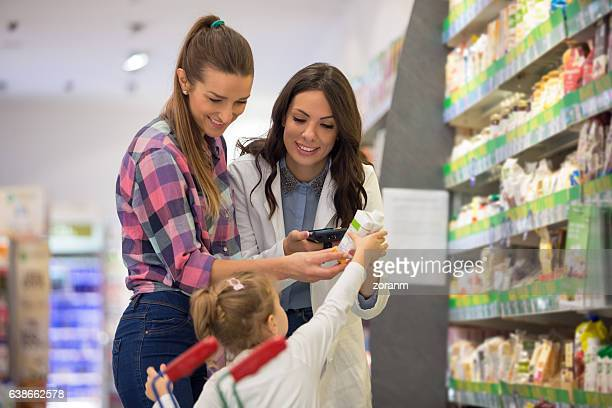 Sales clerk with mother and daughter
