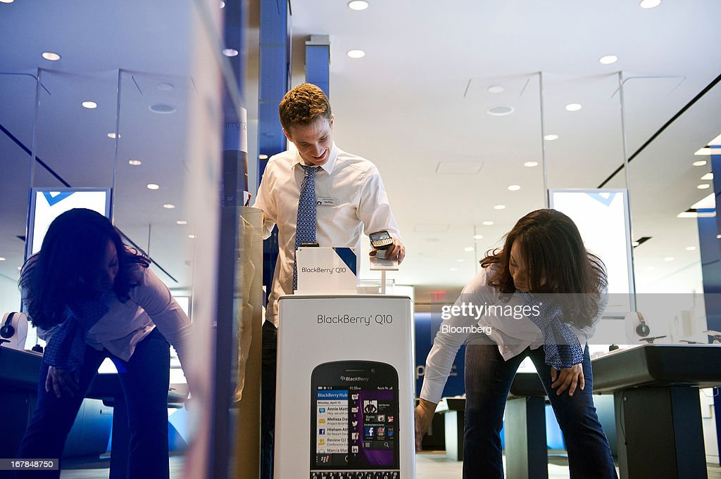 Sales consultant Geoffrey Newsome, left, and corporate store manager Diane Baxter prepare a BlackBerry Q10 display at a Bell Canada retail location in Toronto, Canada, on Tuesday, April 30, 2013. BlackBerry, the Canadian smartphone maker, climbed to its highest level in more than a month after Chief Executive Officer Thorsten Heins said he sees sales of its new Q10 device to be in the 'tens of millions.' Photographer: Galit Rodan/Bloomberg via Getty Images