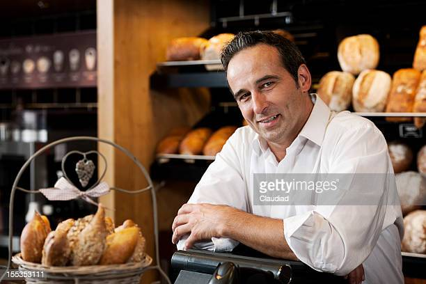 Sales executive behind counter in bakery