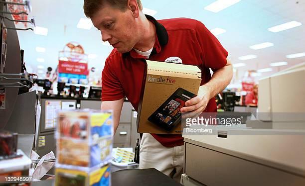 Sales Floor Team Leader Chris Davis unpacks boxes of Amazoncom Inc Kindle Fire tablet computers at a Super Target store in Denver Colorado US on...