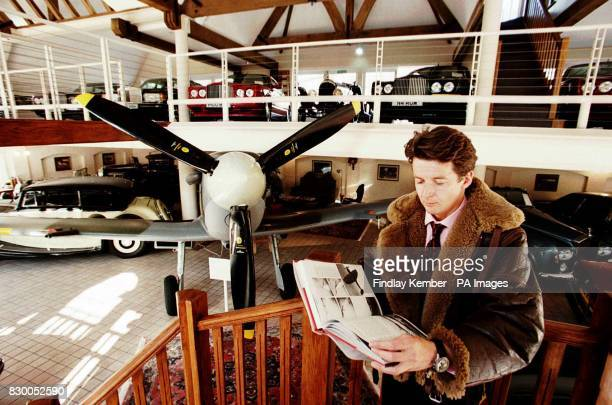 Sales Manager Lee MaxtedPage of P A Wood RollsRoyce car dealers of Great Easton Dunmow Essex today looks at a Spitfire history book whilst wearing an...