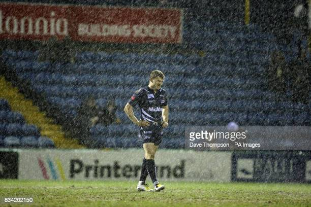 Sale's Mark Cueto in the rain during the Guinness Premiership match at Edgeley Park Stockport