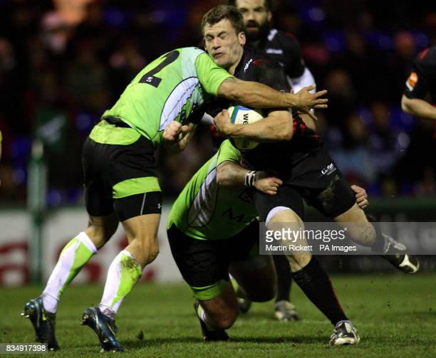 Sale's Mark Cueto is tackled by Montauban's Shannon Paku during the Heineken Cup match at Edgeley Park Stockport