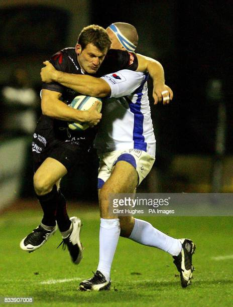 Sale's Mark Cueto is tackled by Montpellier's Clement Baiocco during the European Challenge Cup match at Edgeley Park Stockport