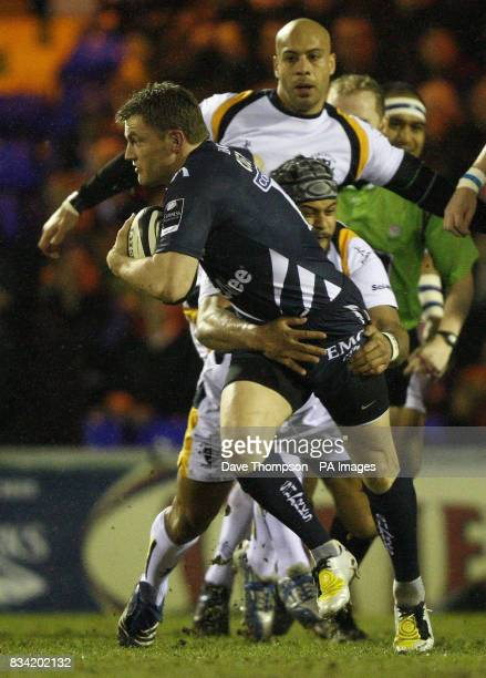 Sale's Mark Cueto is tackled by Worcester's Sam Tuitupou during the Guinness Premiership match at Edgeley Park Stockport