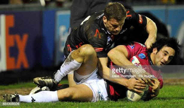 Sale's Mark Cueto tackles Brive's Gregory Mahe during the European Challenge Cup match at Edgeley Park Sale