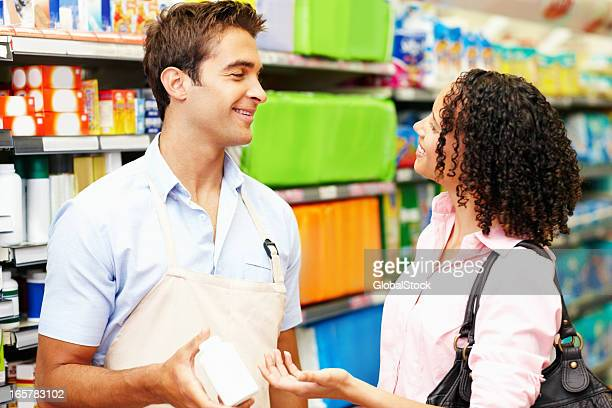 Sales person assisting female shopper
