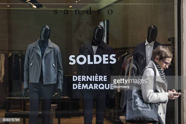 A sales promotion sign sits on the window of a Sandro luxury clothing store operated by SMCP Group in Toulouse France on Wednesday Feb 10 2016...