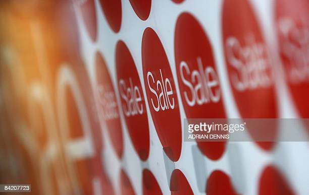 Sales signs are pictured in an electronics shop window in Hounslow west London on January 8 2009 The Bank of England on Thursday cut its key lending...