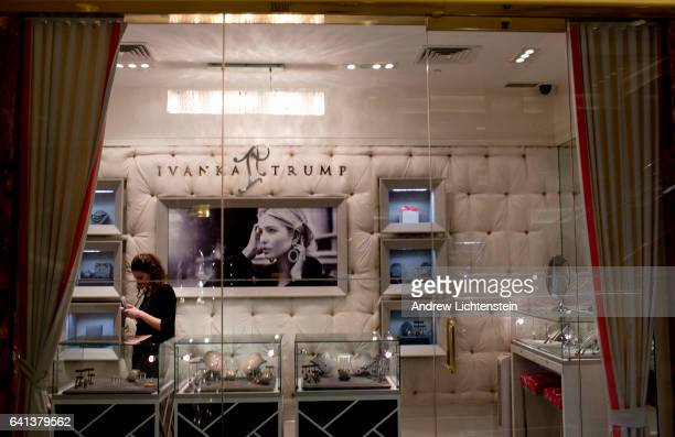 A sales woman checks her cell phone at the Ivanka Trump store located inside of Trump Tower on February 8 2017 in midtown Manhattan New York City...