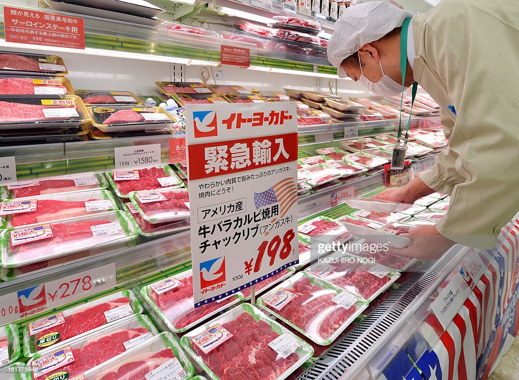 A salesman arranges imported beef, under 30 months old from the US at a Ito-Yokado supermarket in Tokyo on February 16, 2013. The United States on January 28 welcomed news that Japan has eased restrictions on beef imposed due to concerns over mad cow disease, easing a decade-long row between the allies. US officials said that Japan -- formerly the largest buyer of US beef -- had agreed to allow the import of the meat from cattle slaughtered at up to 30 months old, higher than the earlier safety limit of 20 months. AFP PHOTO / KAZUHIRO NOGI