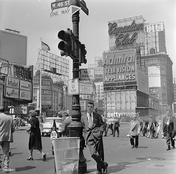 A salesman bides his time in Times Square Manhattan New York
