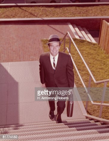 Salesman climbing stairs, elevated view. (Photo by H. Armstrong Roberts/Retrofile/Getty Images) : Stock Photo