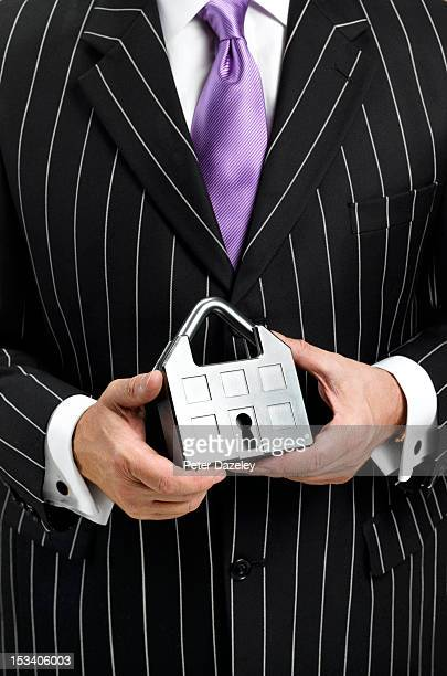 Salesman holding house shaped padlock