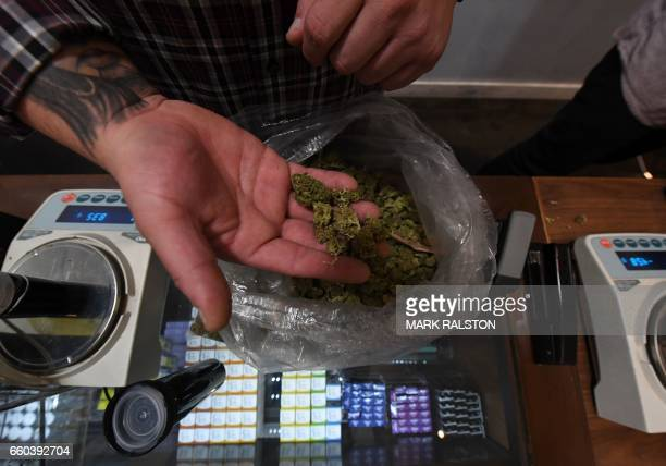 A salesman prepares an order of marijuana products at the Perennial Holistic Wellness Center which is a medicinal marijuana dispensary in Los Angeles...